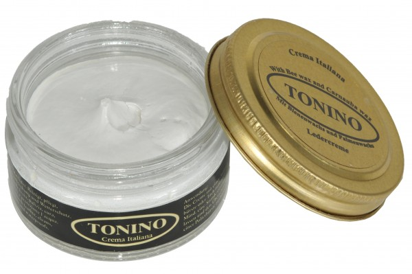 White Tonino leather cream in the glass. Care + protection.